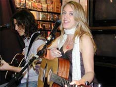 Liz Phair with Dino Meneghin at Sunrise Records in Toronto
